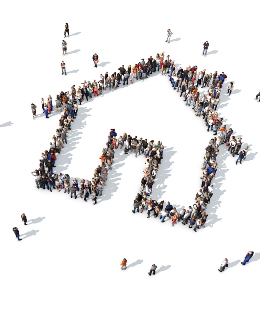 View of a crowd of tenants from above forming the shape of a home
